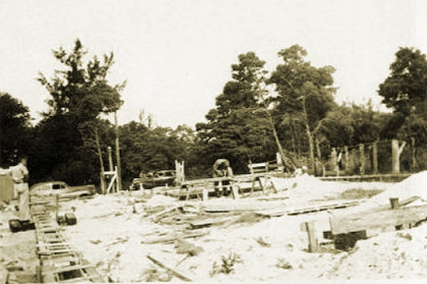 "Alt Text: Construction begins for Blumer & Stanton's ""Sales Office"", early 1946."